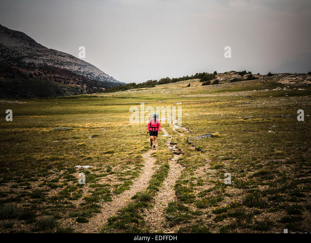 A female backpacker. - Stock Image