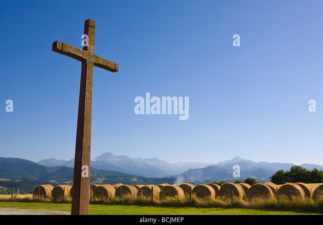 Crucifix & Hay Bales, Chapel Cieutat, Hautes-Pyrenees, France - Stock Image