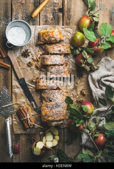 Apple strudel cake with cinnamon, nuts and sugar powder - Stock Image