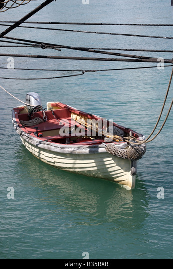A dingy boat tied up to the US Brig Niagara - Stock Image