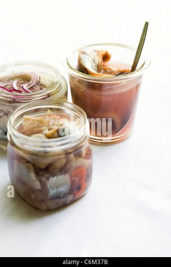 Pickled herring in jars - Stock Image