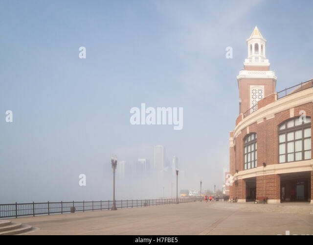 the Chicago skyline in the distance, obscured by a heavy advection fog off Lake Michigan, as seen from outside the - Stock Image