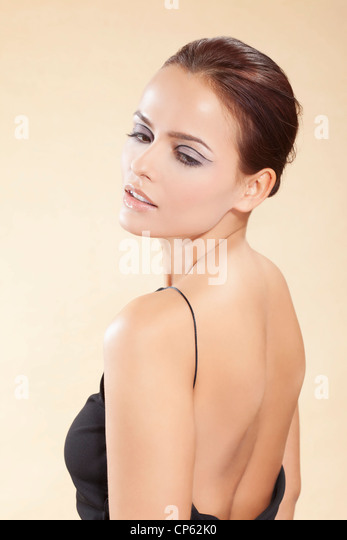 Young woman in black dress, close up - Stock Image