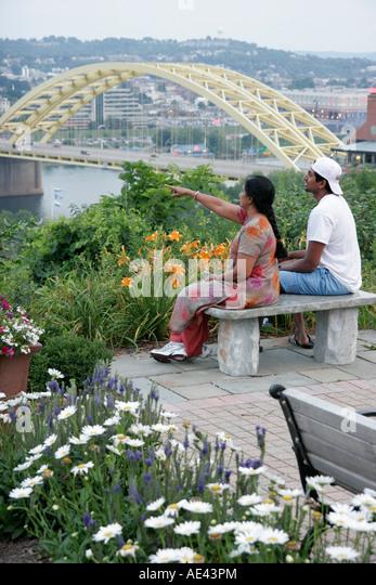 Ohio Cincinnati Mount Adams Historic Neighborhood Asian mother adult son Ohio River view - Stock Image