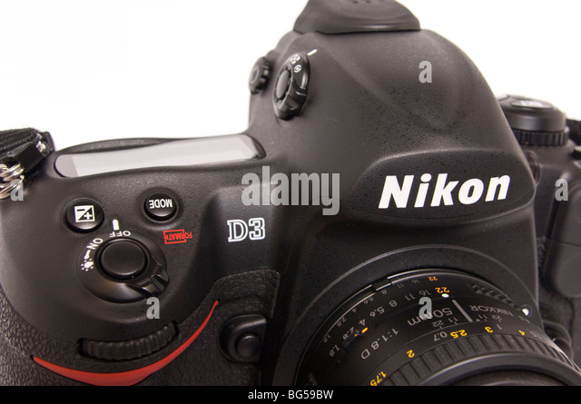 A Nikon D3 digital DSLR full frame (FX) flagship model professional camera with 50mm lens attatched on a white background - Stock Image