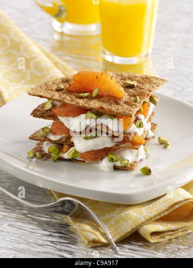Gourmet grapefruit breakfast napoleon served with orange juice - Stock Image