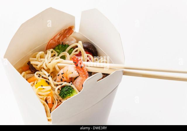 Take away Egg noodles with shiitake mushrooms, shrimp and pork - Stock Image