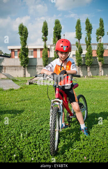 Young Boy in Helmet on Mountain Bike - Stock Image