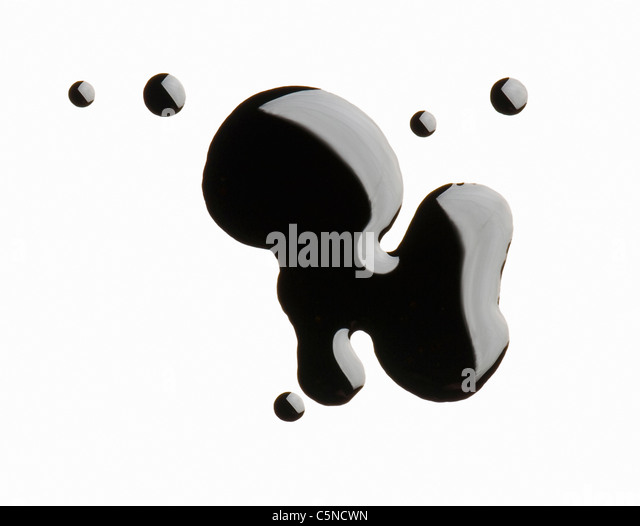 Oil on a white surface - Stock Image