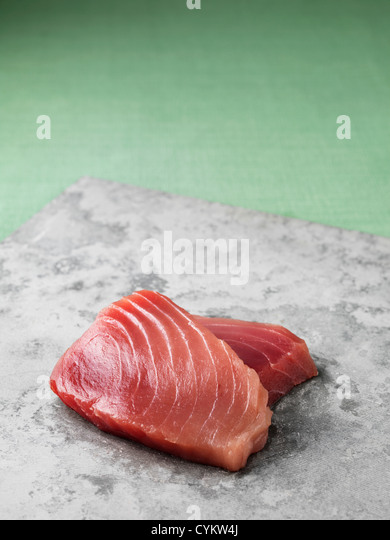 Tuna filets on marble board - Stock Image