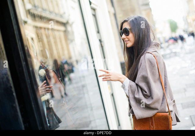 Young woman window shopping - Stock Image