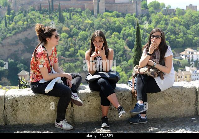 Girls women females sitting talking in Granada Spain - Stock Image