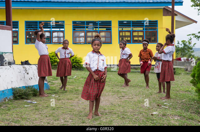 JAYAPURA, WEST PAPUA, INDONESIA - CIRCA FEBRUARY 2016: Schoolkids playig outside the schoolhouse during a break - Stock Image