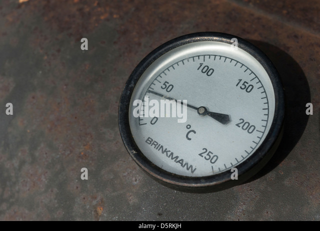 Close up of a thermometer on a Brinkmann BBQ - Stock Image