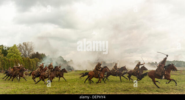 Lomianki, Poland. 22nd Sep, 2013. 22nd September, 2013. Polish cavalry ride their horses during Battle at Lomianki - Stock Image