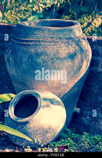 Ancient earthen water vessels - Stock Image