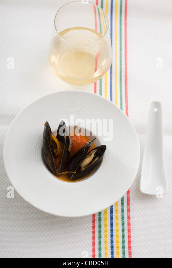 Mussels with tomato sauce and peppers - Stock-Bilder