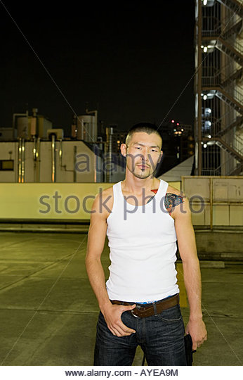 Japanese man with urban backdrop - Stock Image