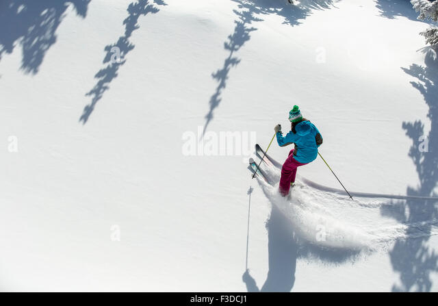 Elevated view of woman skiing - Stock-Bilder