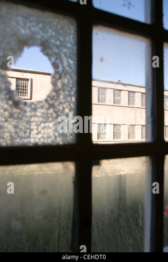 Hole in a glass window - Stock Image