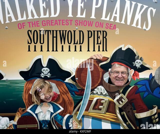 grandad and grandaughter having fun on southwold pier UK - Stock Image