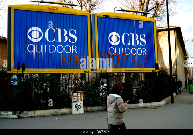 Paris France, Street Scene, Outdoor Advertising Billboards, Posters on Street, Tagged with Anti Advertising Slogans - Stock Image
