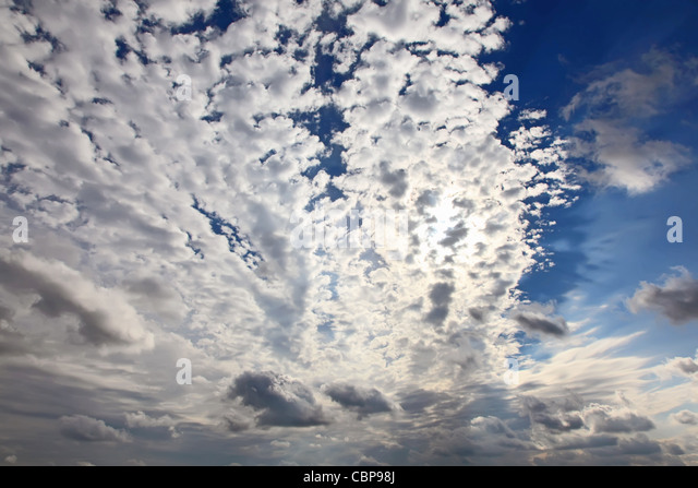 Blue sky background. Clouds against sun. Hi-resolution background for your artwork. - Stock Image