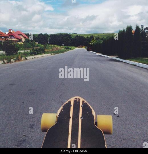 View of skateboard on road - Stock-Bilder