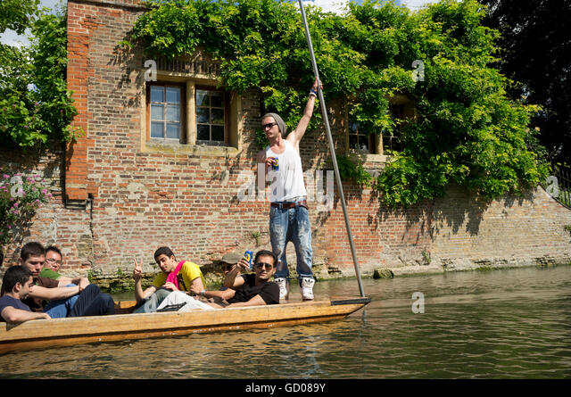 Group of guys drinking whilst punting on the River Cam, Cambridge - Stock Image