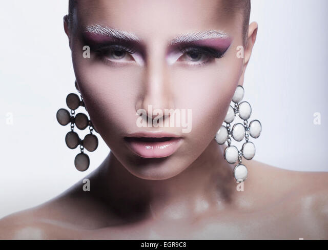 Glamor. Trendy Woman with Pearly Eardrops - Stock Image