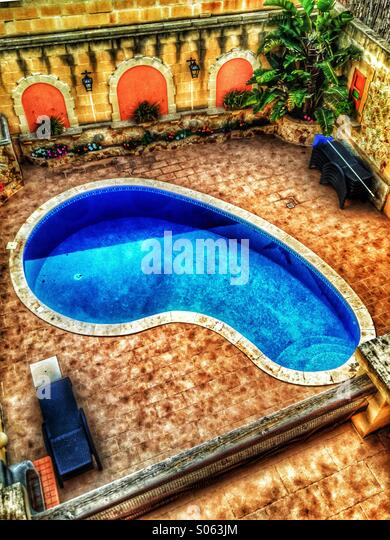 High view of Gozo farmhouse swimming pool - Stock Image