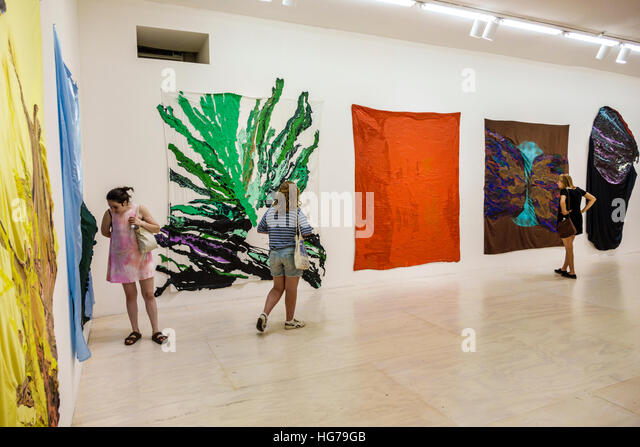 New York New York City NYC Queens Long Island City MoMA PS1 interior contemporary art video man headset exhibit - Stock Image