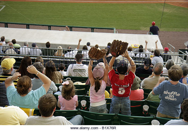 Arkansas North Little Rock Dickey Stephens Park minor league baseball Arkansas Travelers man boy girl parent family - Stock Image