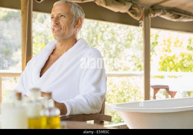 Man relaxing in spa - Stock Image