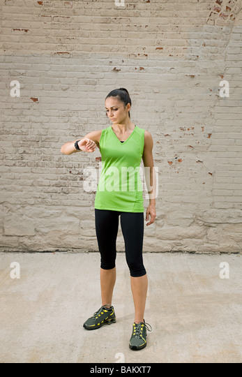 Runner looking at watch - Stock Image