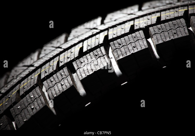 Part of brand new car tyre close-up. Horizontal composition. - Stock-Bilder