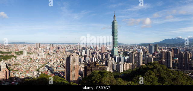 A wide panoramic view of Taipei Skyline during clear summer day. With Taipei 101, the world tallest Skyscraper. - Stock Image