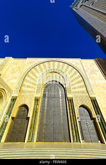 Casablanca Morocco Hassan II Mosque external door detail and tower - Stock Image