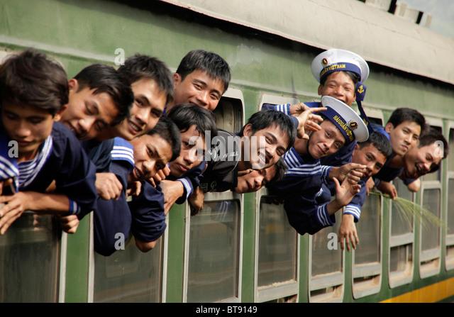 Vietnamese sailors in a train, Central Vietnam, Asia - Stock Image