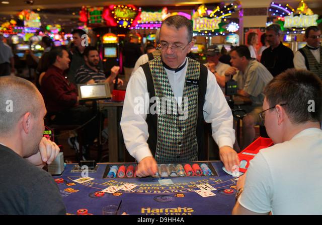 Nevada Las Vegas The Strip South Las Vegas Boulevard Harrah's Las Vegas Hotel casino gambler gambling dealer - Stock Image