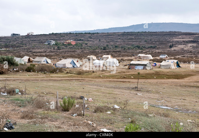 A tent village for Syrian refugees in the northern Lebanese region of Wadi Khaled, just south of the Syria-Lebanon - Stock Image