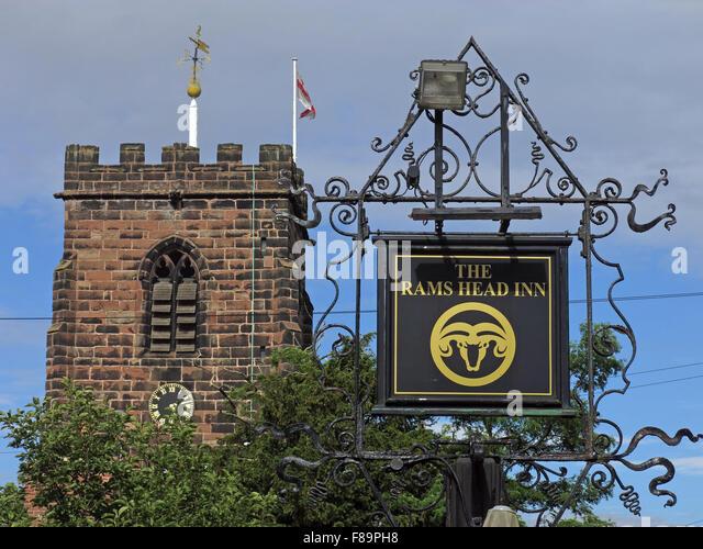 Rams Head inn sign & St Wilfrids Church tower ,Grappenhall,Warrington,Cheshire,England,UK - Stock Image