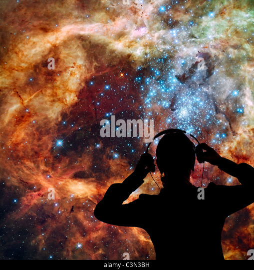 audio engineer monitoring sounds and noises from outer space - Stock Image