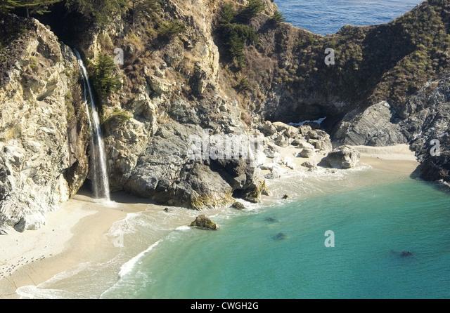 Waterfall Onto Beach - Stock Image