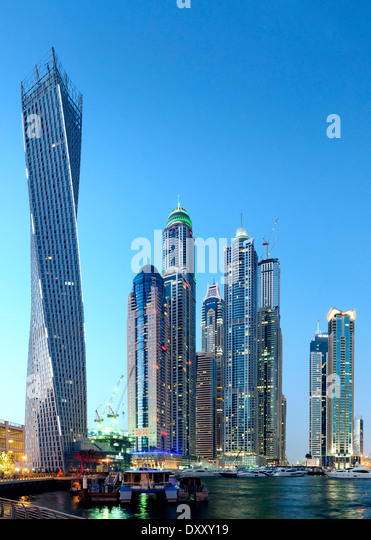 Twilight skyline view of modern skyscrapers in MArina district in Dubai United Arab Emirates - Stock Image