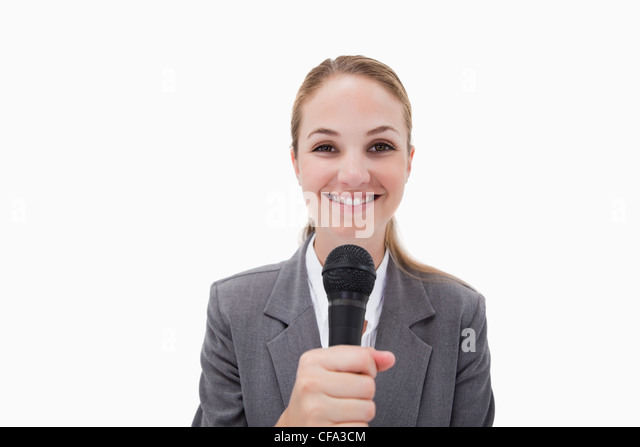 Smiling woman with microphone - Stock Image
