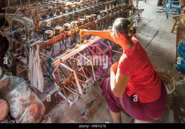 Silk Weaving Factory Worker near Amarapura, Myanmar - Stock-Bilder