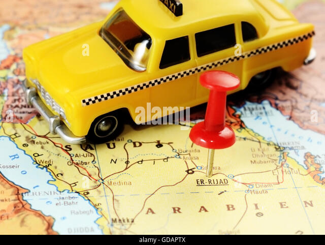 Close up of  Er Riyadh,Saudi Arabia   map with red pin and a taxi car - travel concept - Stock Image