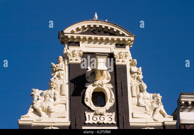 Amsterdam Jourdan district typical architecture canal house pediment with lifting block - Stock Image