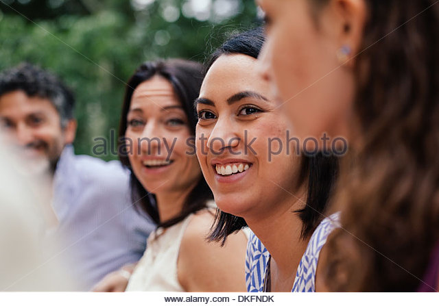 Young woman amongst family members - Stock Image